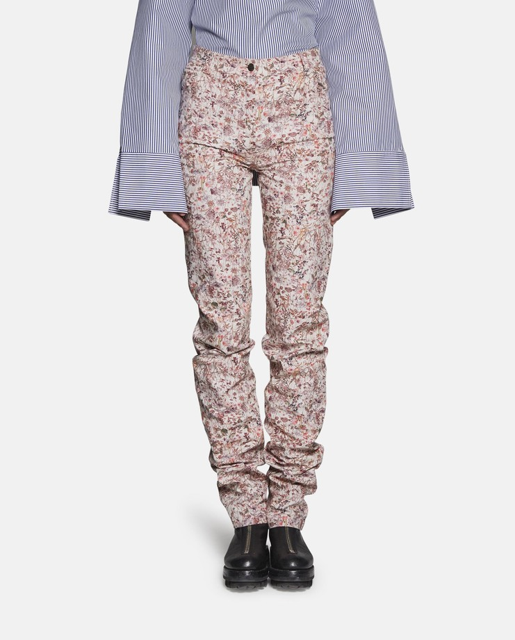 "Slim leg jeans from the DELADA S/S 17 debut collection. These high waisted extra long jeans uniquely gather on the legs, as a deliberate design feature. The trousers are finished with a printed ""Strawberry Fields"" pattern on the cotton outer layer."