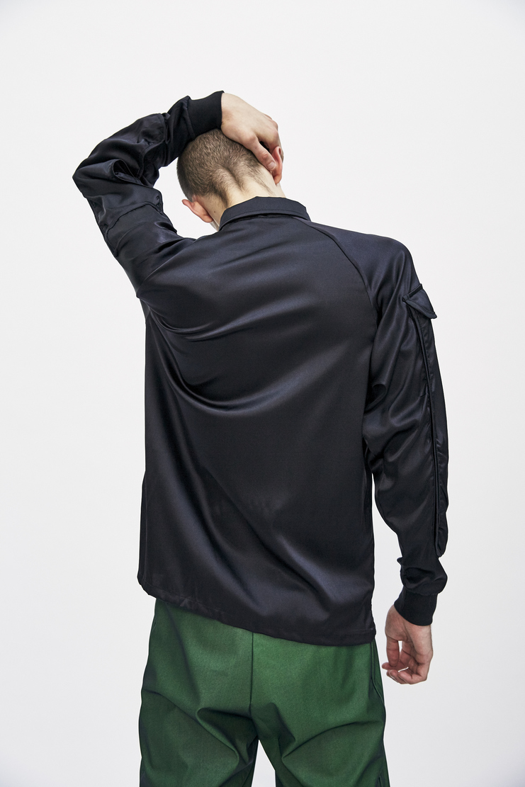 Black Utility Shirt from Cottweiler's A/W 17 collection. The shirt features a classic collar, front button fastening, long sleeves and elongated chest and sleeve pocket details.