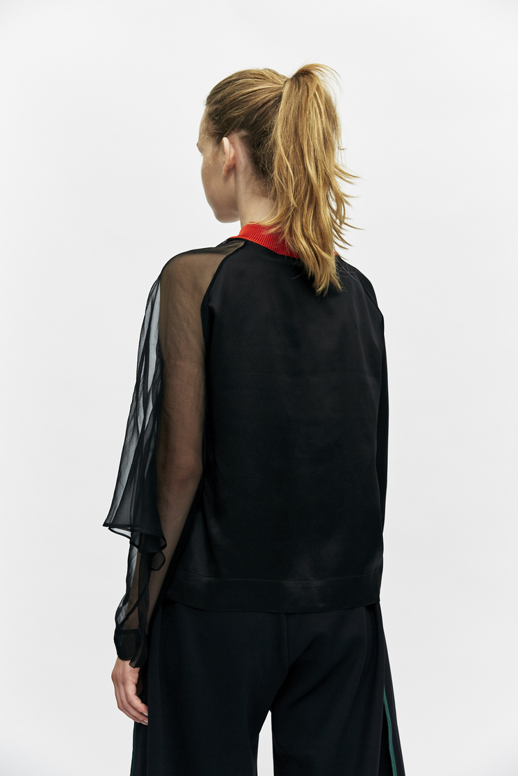 Black Sheer Sleeve Top from Martina Spetlova's A/W 17 collection. The top features a red ribbed neck detail, long sleeves and one sheer sleeve.