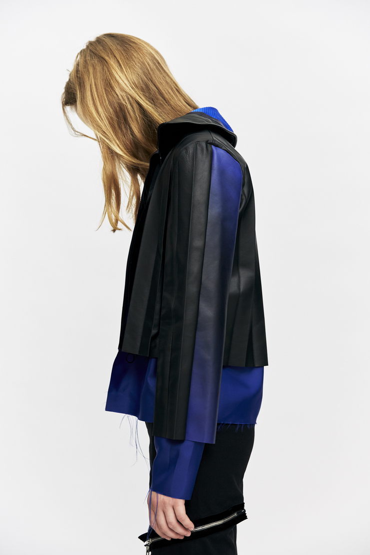 Black and navy Pleated Layered Jacket from Martina Spetlova's A/W 17 collection. The jacket features a classic collar, rear pleat detailing and an exposed satin lining.